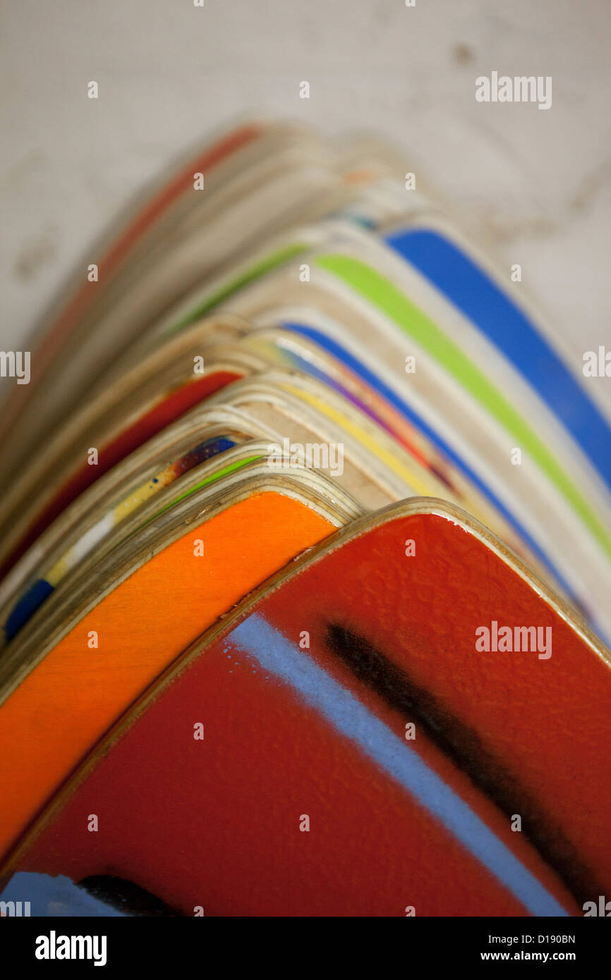 Colourful hand painted skimboards - Stock Image