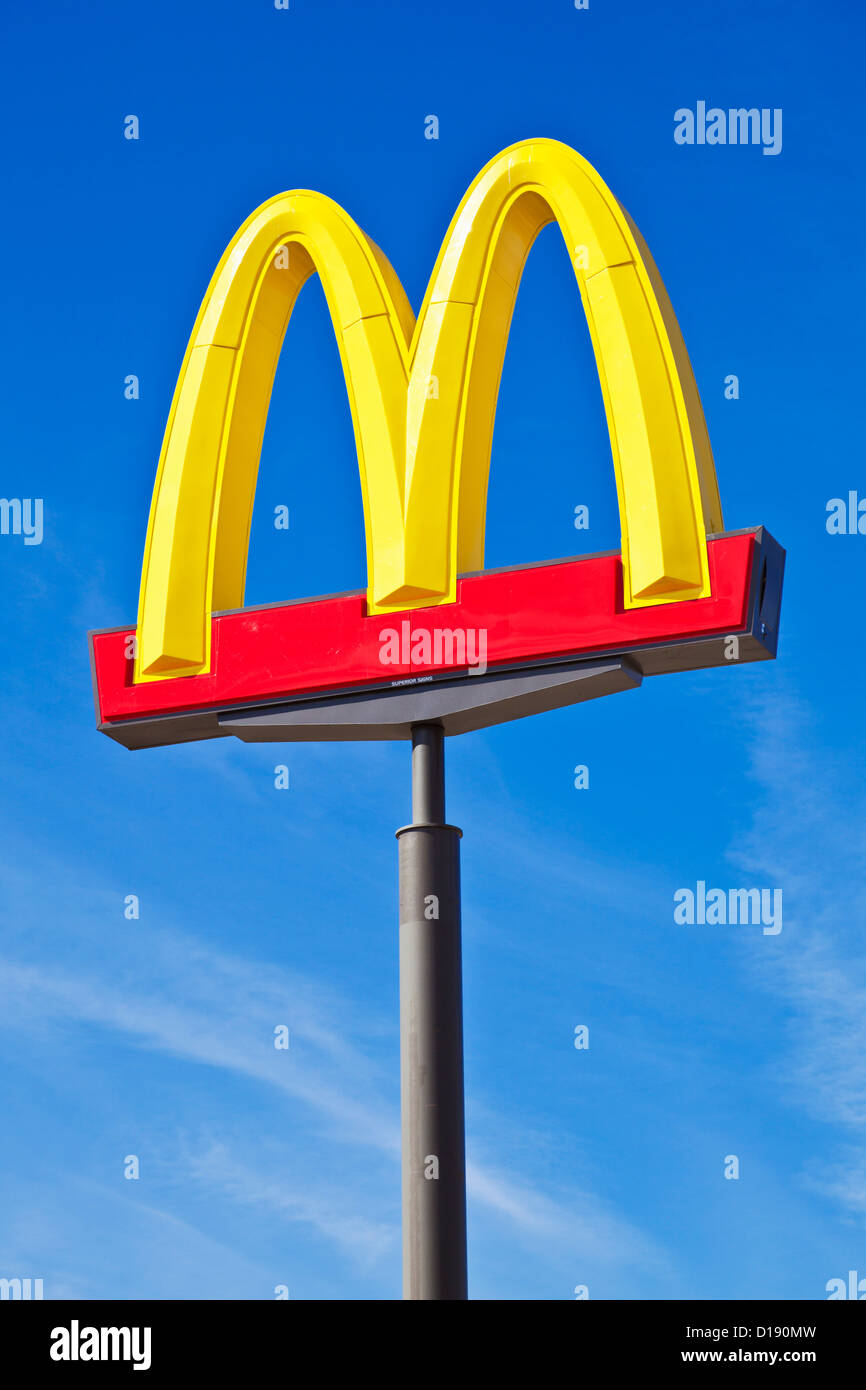 Mcdonald's Logo arches sign against a clear blue sky USA United States of America - Stock Image