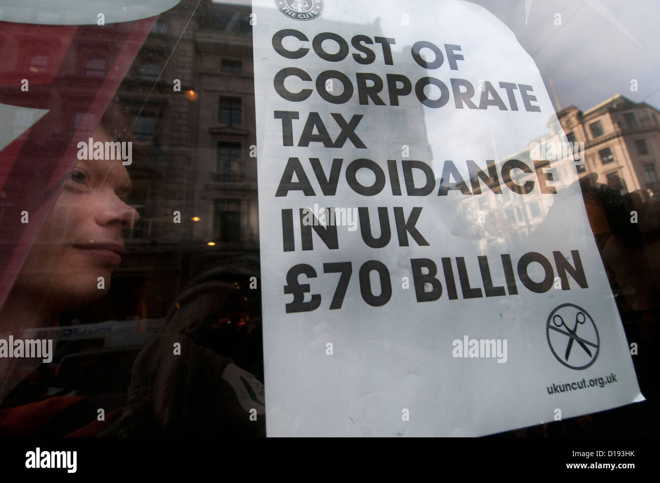 UK Uncut flashmob occupy Starbucks because they have paid no corporation tax for the last three years. - Stock Image