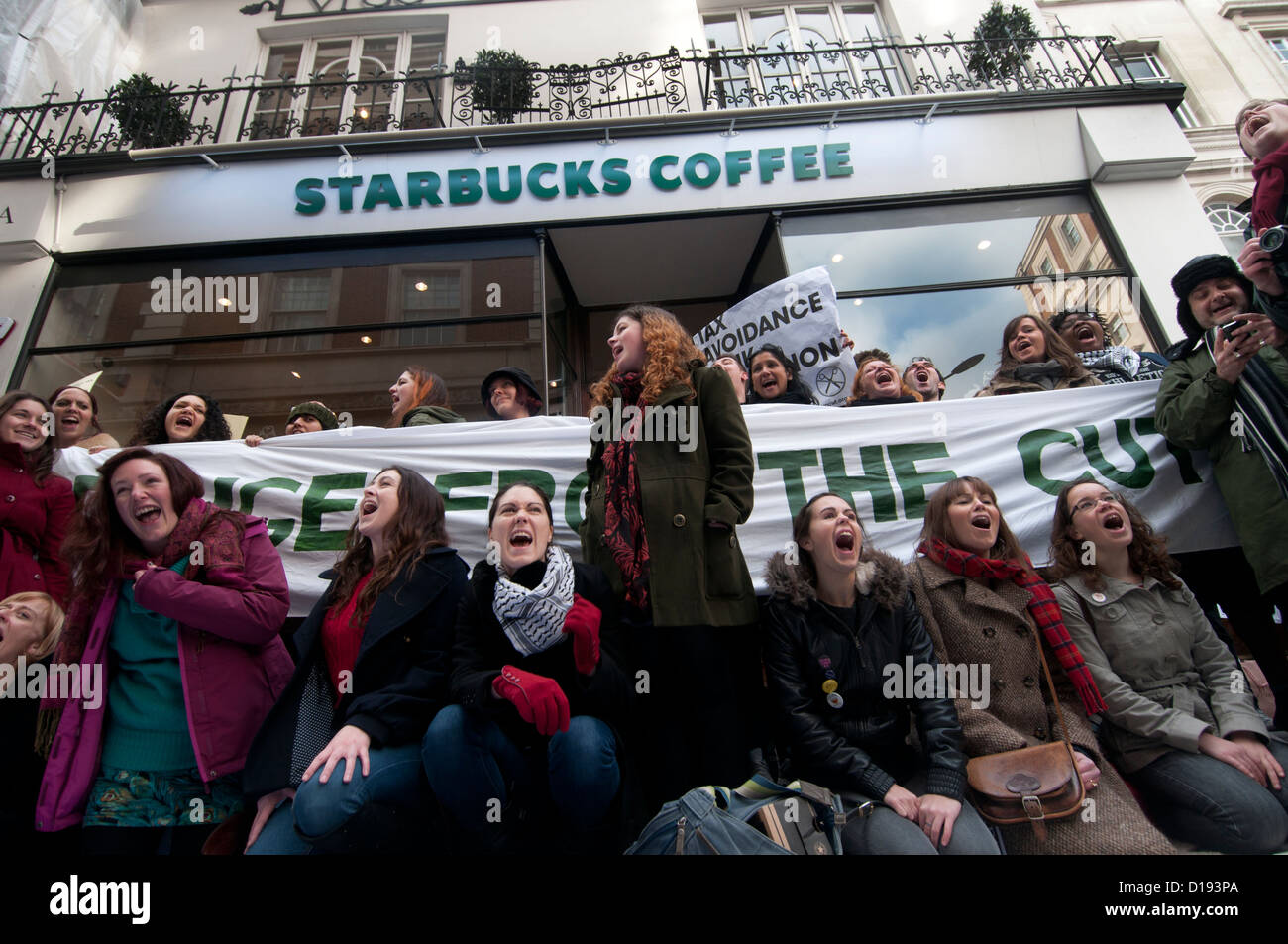 UK Uncut  demonstrate outside Starbucks because they have paid no corporation tax for the last three years - Stock Image