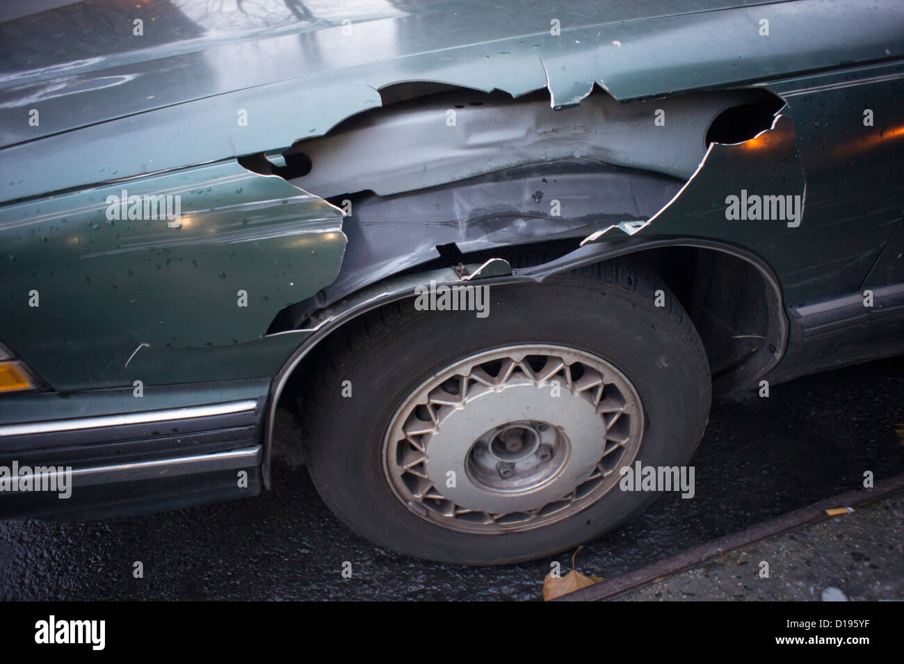 Automobile involved in a minor fender-bender collision is seen parked on the street in the New York neighborhood - Stock Image