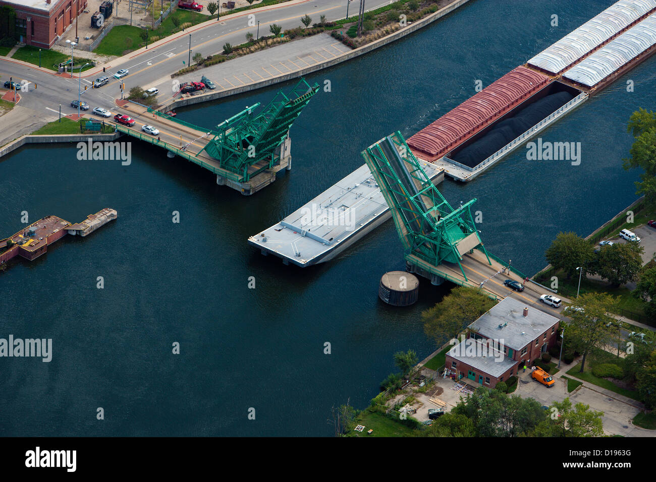 aerial photograph barge passing under bascule draw bridge Joliet, Illinois - Stock Image