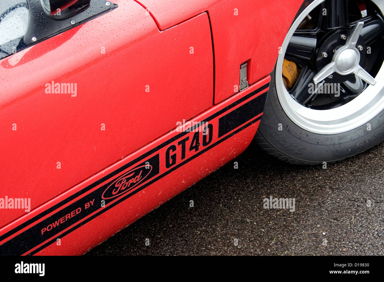 The Front Wheel And Badge Of A Red And Black Ford Gt Supercar Stock