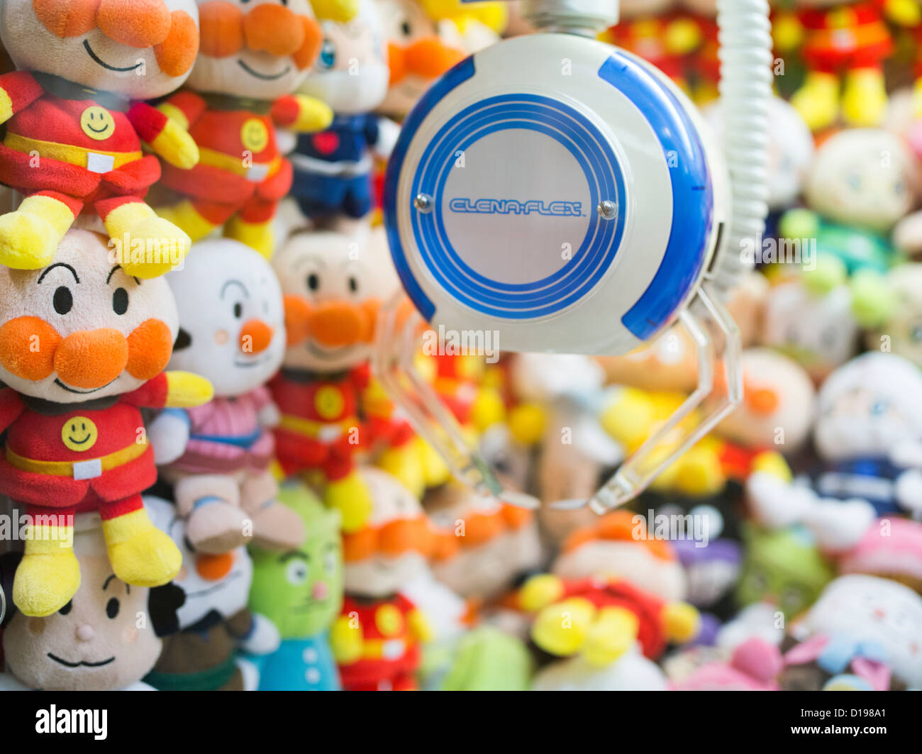 UFO catcher machine in Shinjuku Japan with stuffed toys of popular anime characters inside. - Stock Image