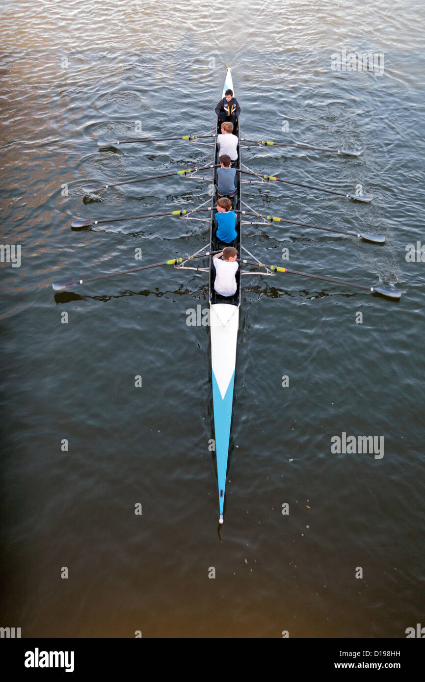 A coxed quad scull, or quadruple scull of teenage boys viewed from above on the River Thames, Henley on Thames, - Stock Image