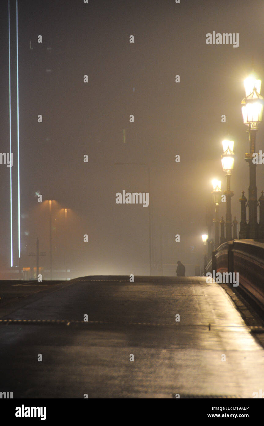 Westminster Embankment, London, UK. 11th December 2012. A man on Westminster Bridge in the fog. The Central London - Stock Image