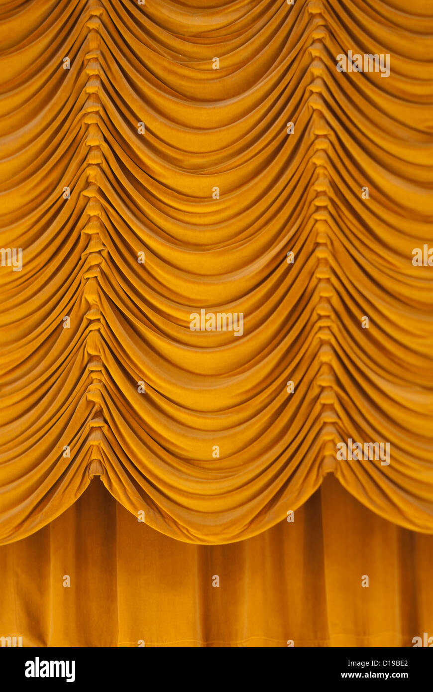 A photograph of a drawn stage curtain. - Stock Image