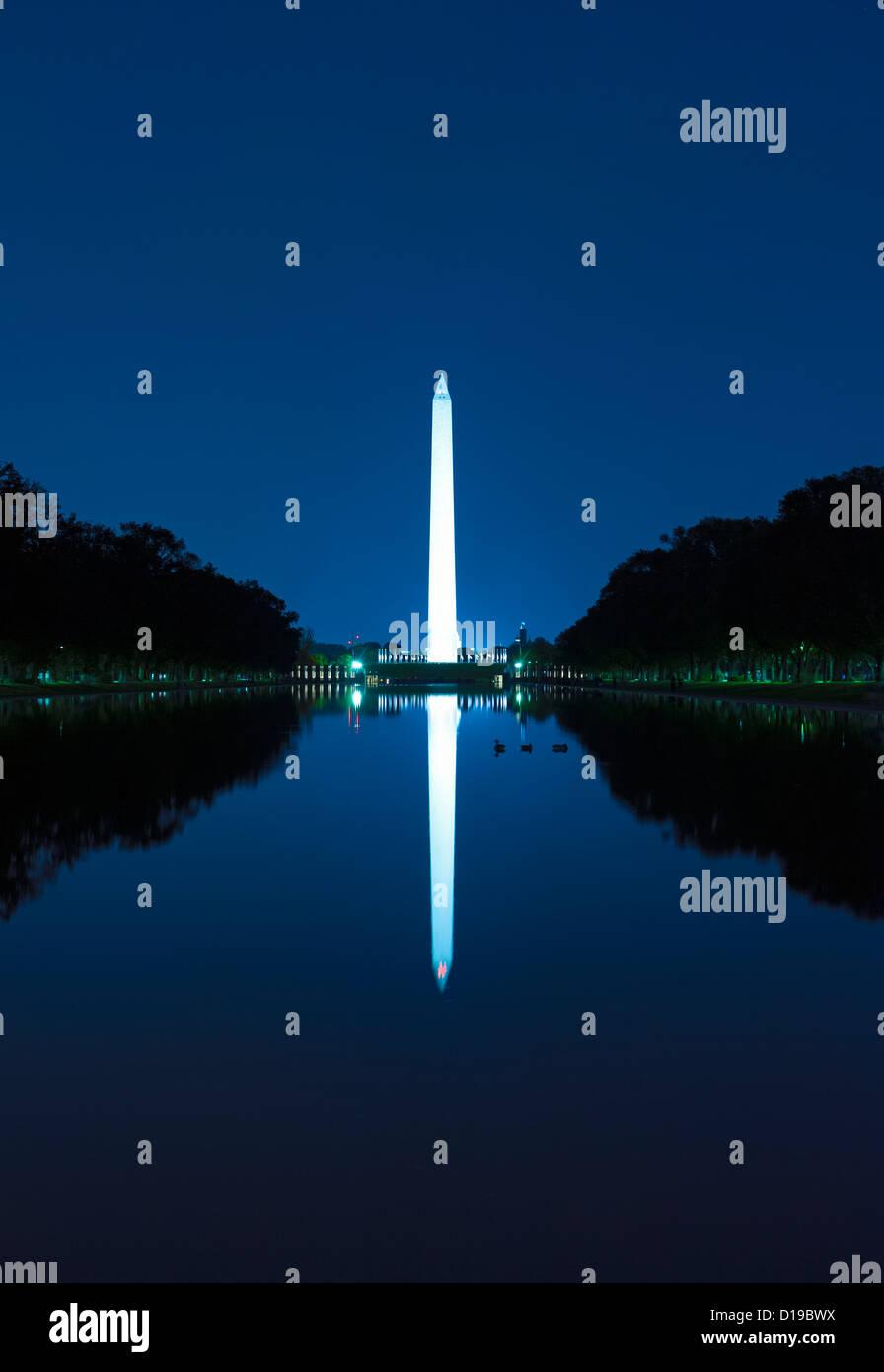 The Washington Monument and reflecting pool at twilight on the National Mall,  Washington DC - Stock Image