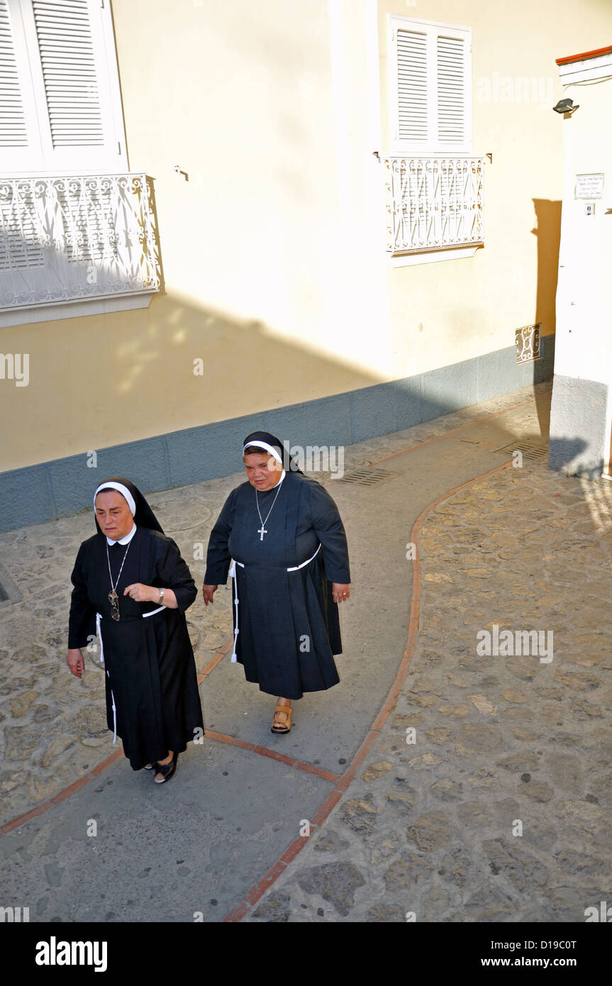 Nuns walking in village square Anacapri Capri Italy Stock Photo