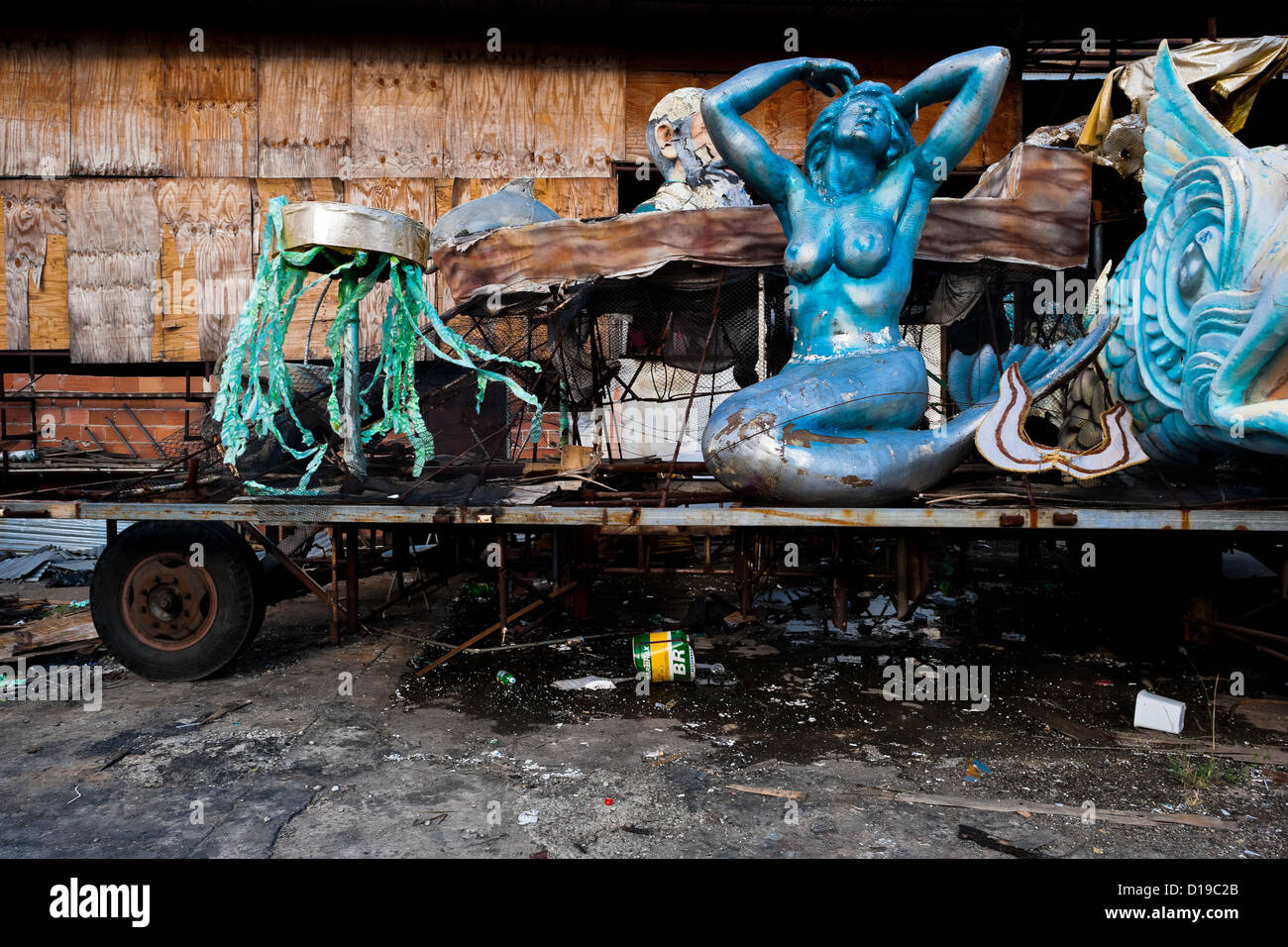 A dismantled carnival float with damaged statues abandoned on the work yard behind the workshops in Rio de Janeiro, - Stock Image