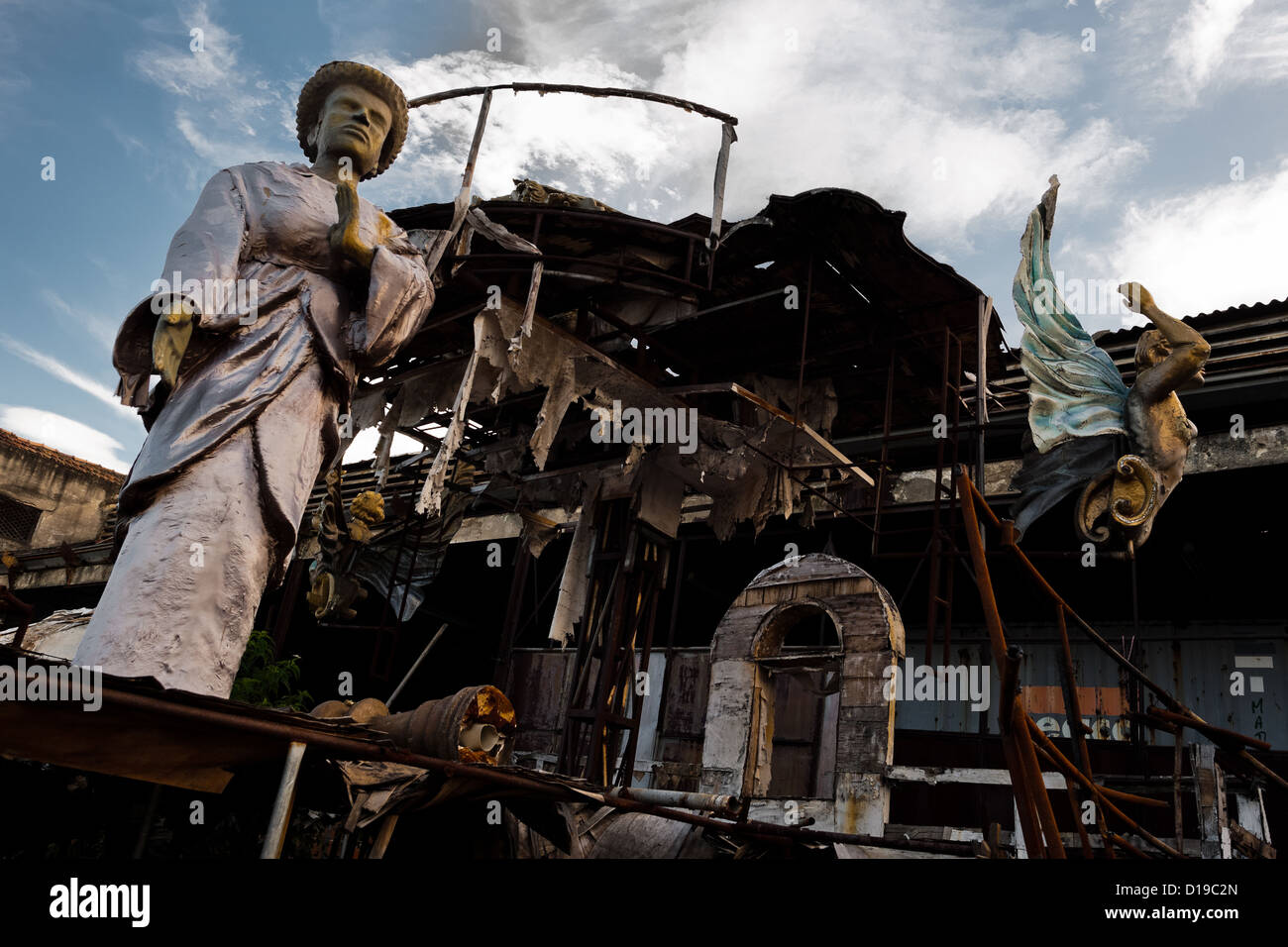 A dismantled and damaged carnival float abandoned on the work yard behind the Samba school workshops in Rio de Janeiro, - Stock Image