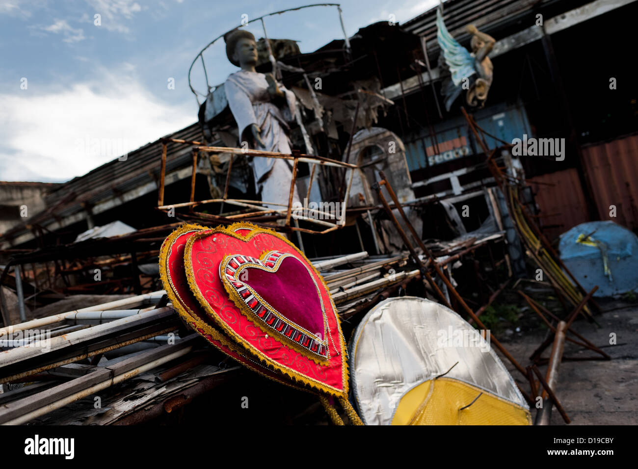 A dismantled carnival float abandoned on the work yard behind the Samba school workshops in Rio de Janeiro, Brazil. - Stock Image