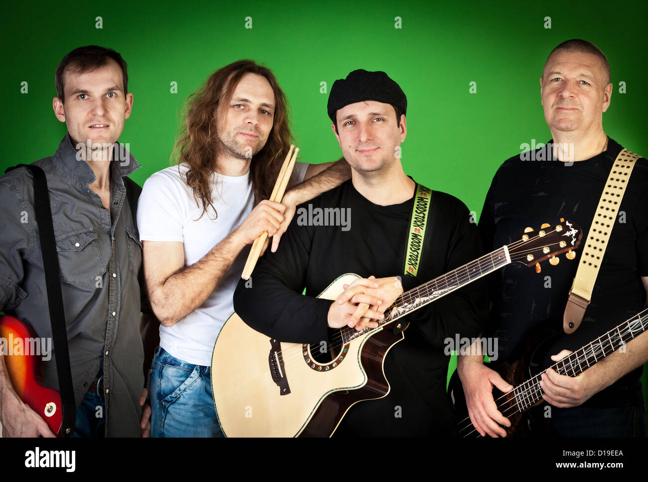 Musical group of artists on a green background - Stock Image