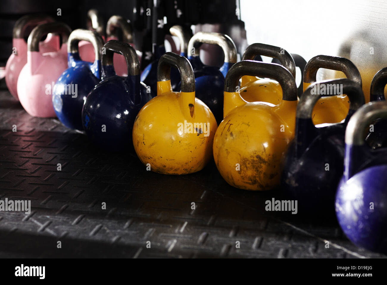 Kettlebells in gym - Stock Image