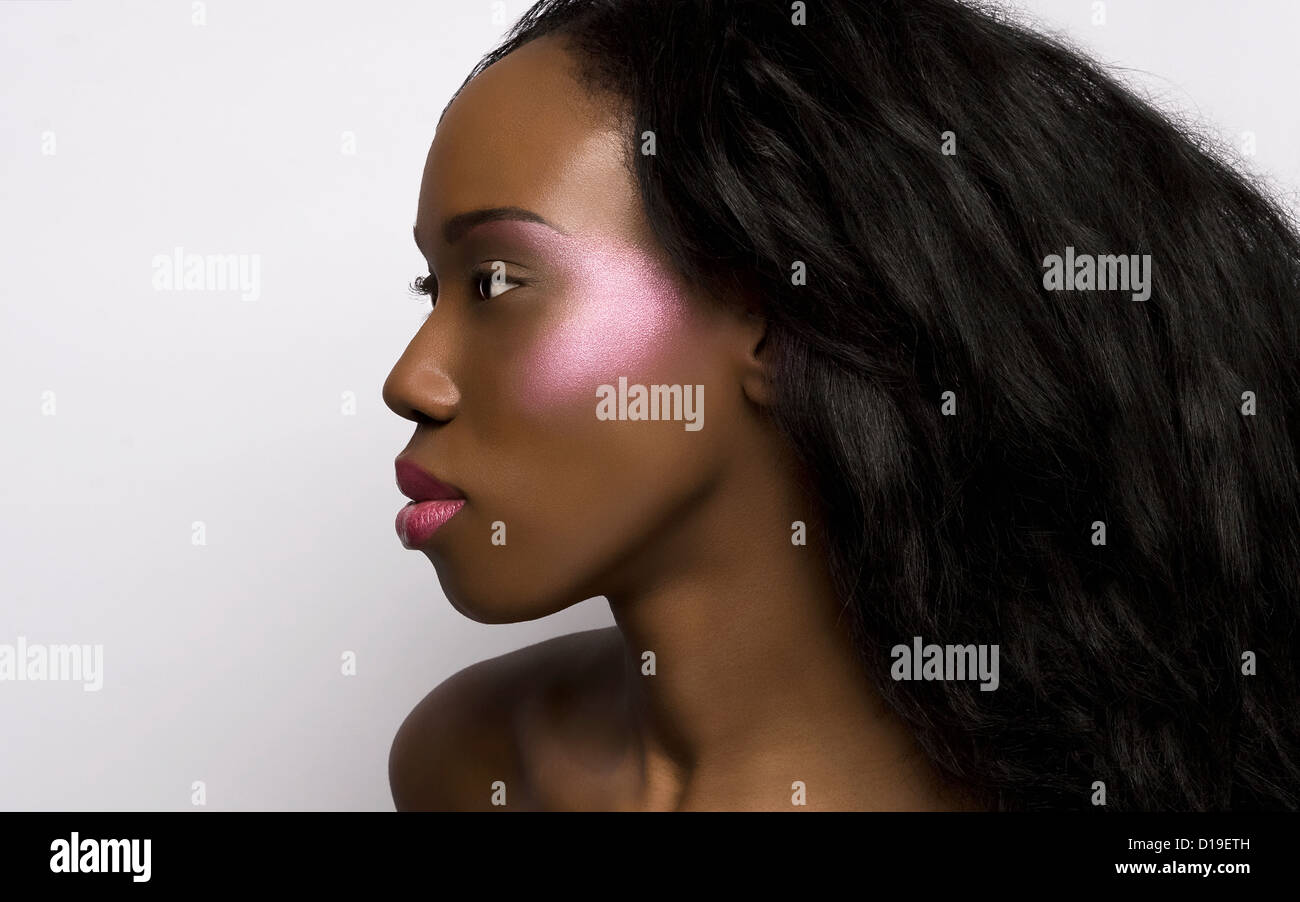 Profile of young woman with metallic makeup - Stock Image