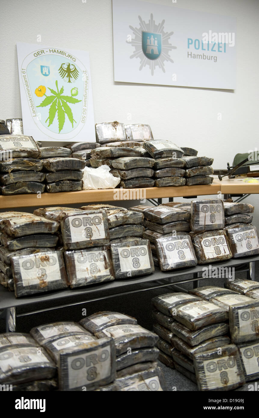Packages of cocaine sit in the police station in Hamburg, Germany, 11 December 2012. The public prosecutor - Stock Image