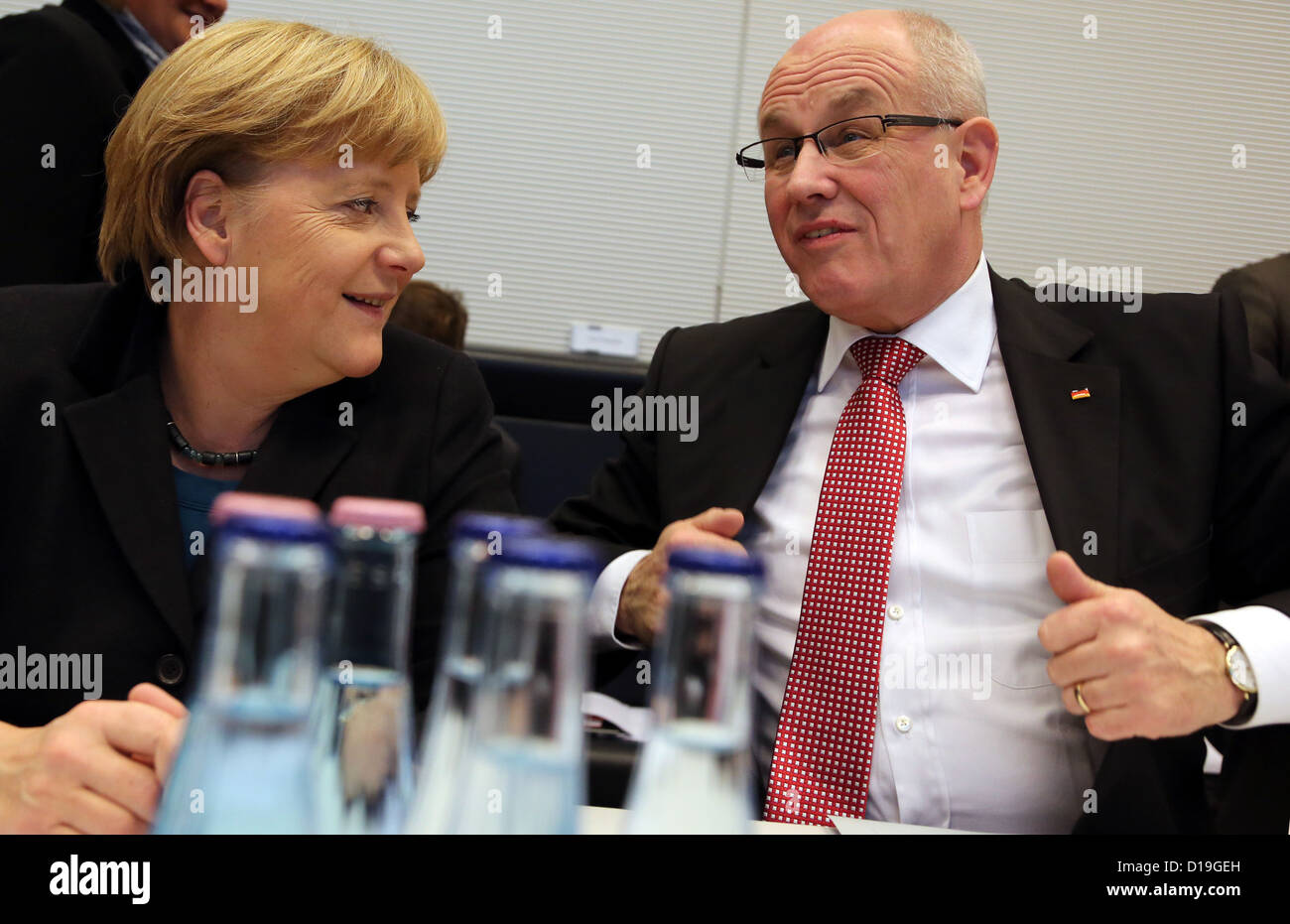 German Chancellor Angela Merkel and CDU/CSU parliamentary party chairman Volker Kauder talk at the start of a meeting Stock Photo