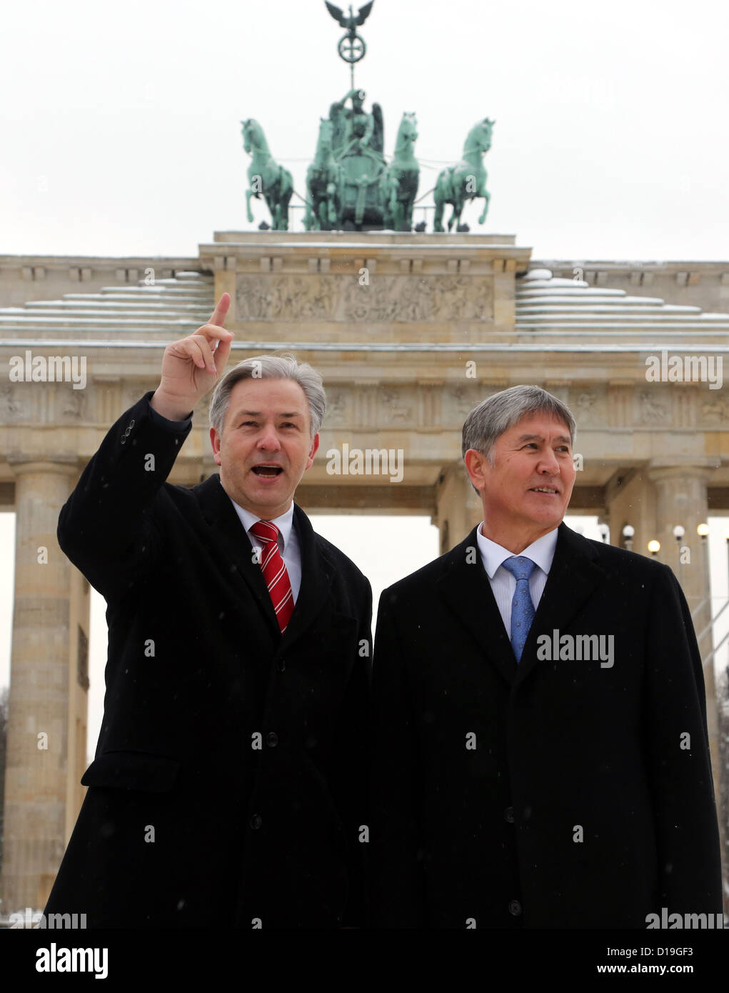 Mayor of Berlin Klaus Wowereit (L) and President of Kyrgyzstan Almazbek Atambayev stand in front of the Brandenburg Stock Photo