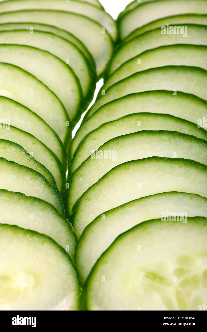 Close up of a cucumber slices isolated on white background - Stock Image