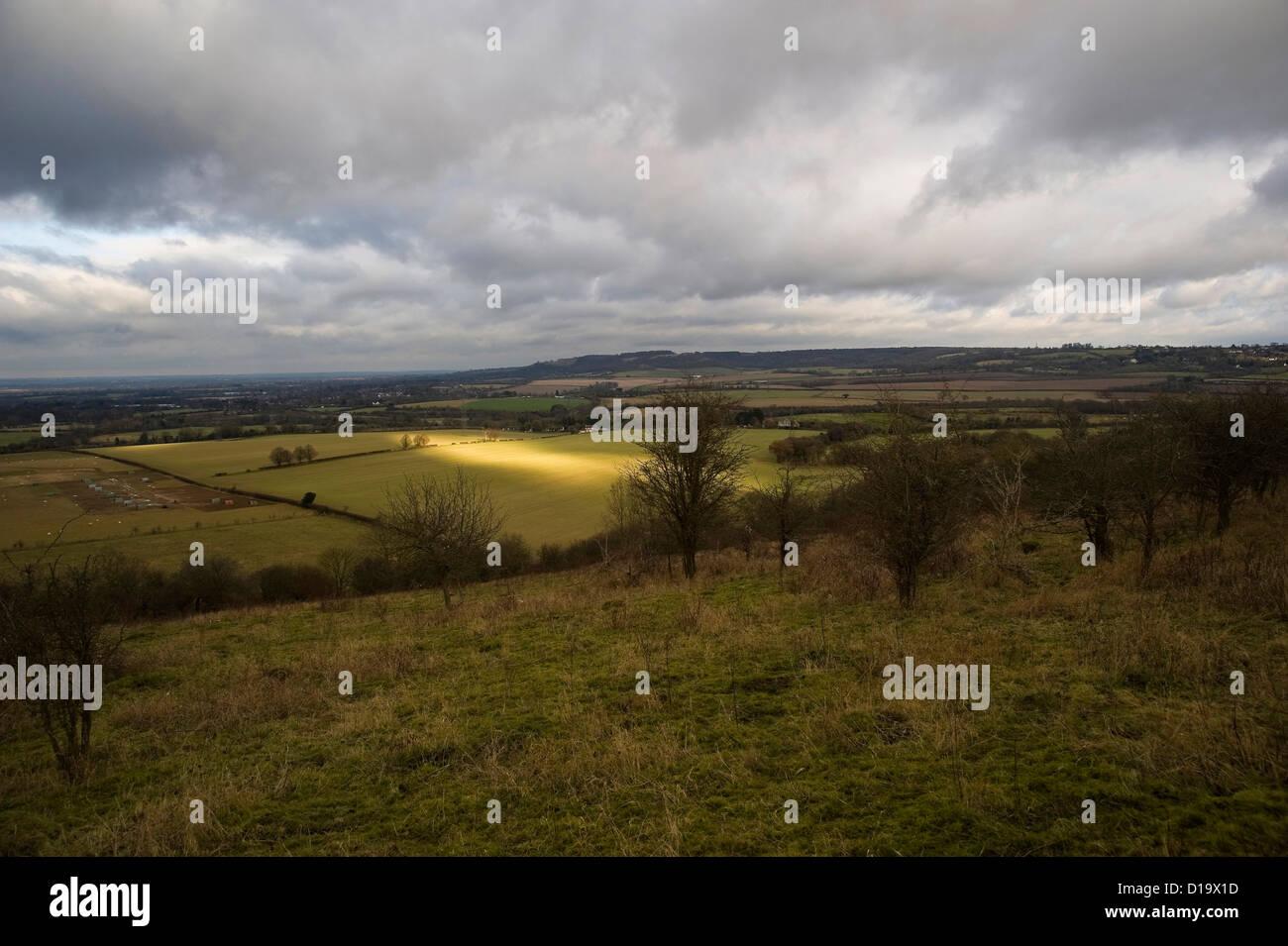 A beam of light moves across fields near The Ridgeway National Trail near Chinnor, Buckinghamshire, UK - Stock Image