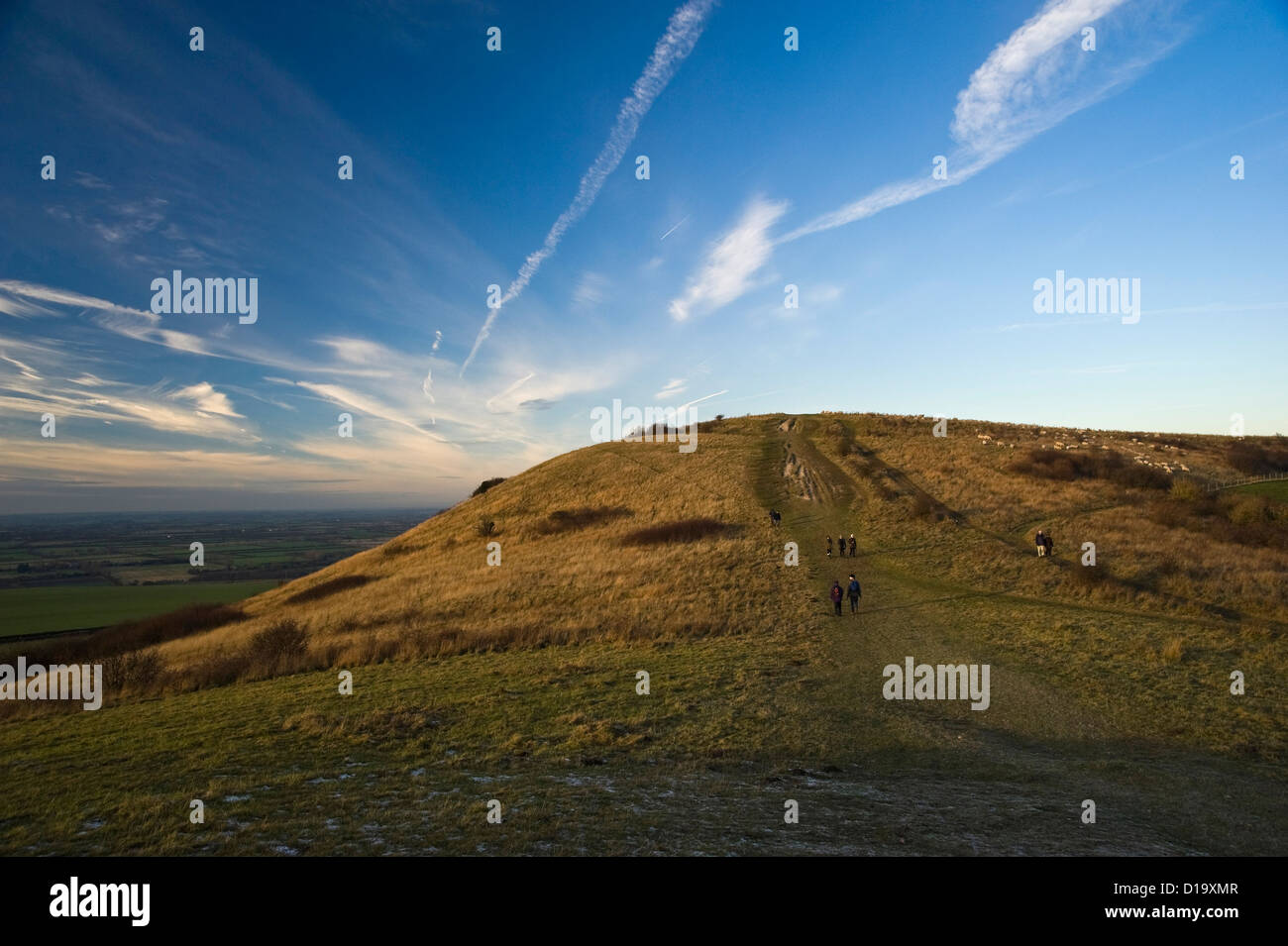 Walkers on Ivinghoe Beacon at the end of The Ridgeway National Trail, Buckinghamshire, UK - Stock Image