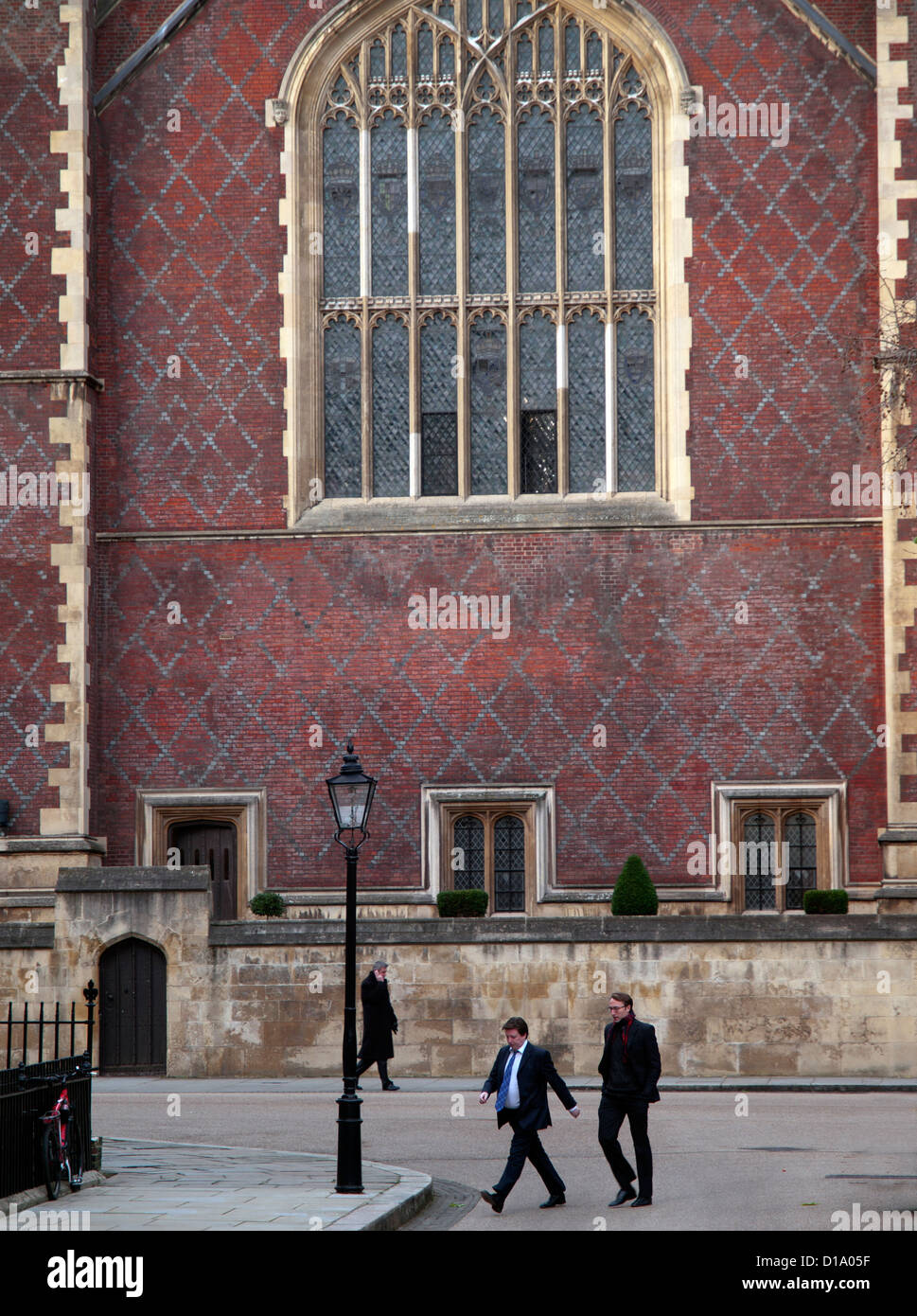 Barristers walk through Lincoln's Inn. - Stock Image
