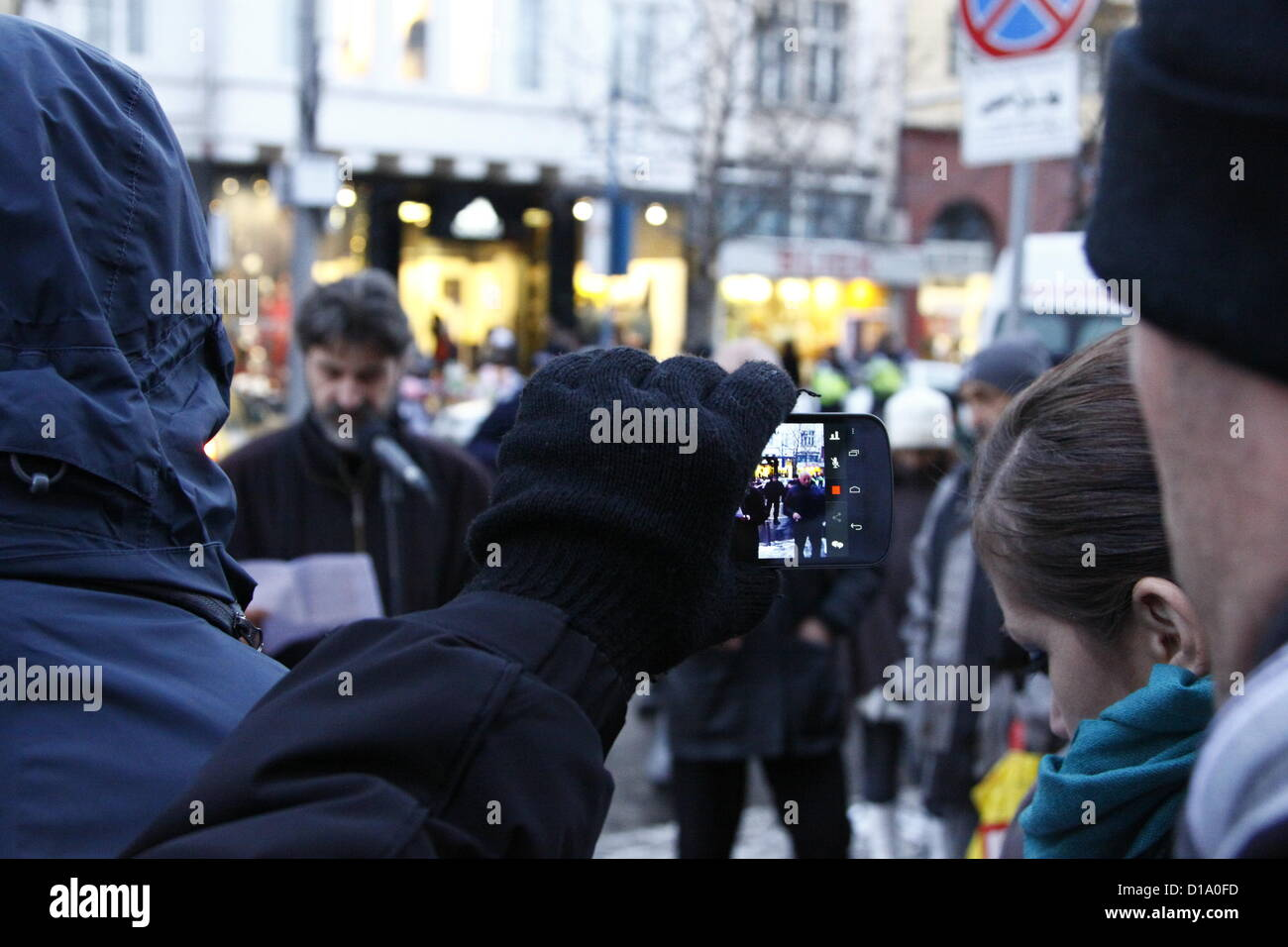 Sofia, Bulgaria; 12th December 2012. A demonstrator filming the 'Tomato Revolution' rally in front of the - Stock Image