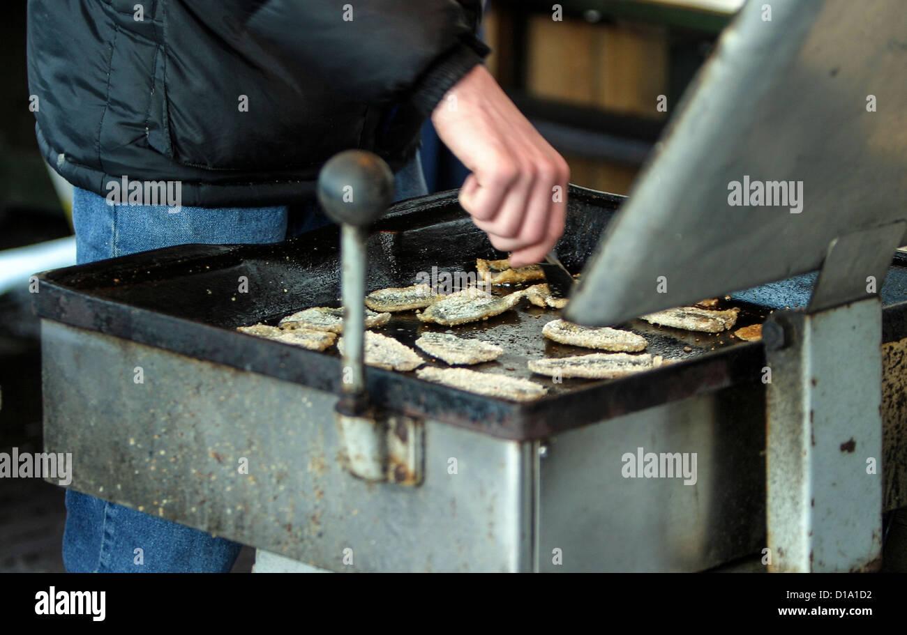 Frying fish (strömming) in Sweden - Stock Image