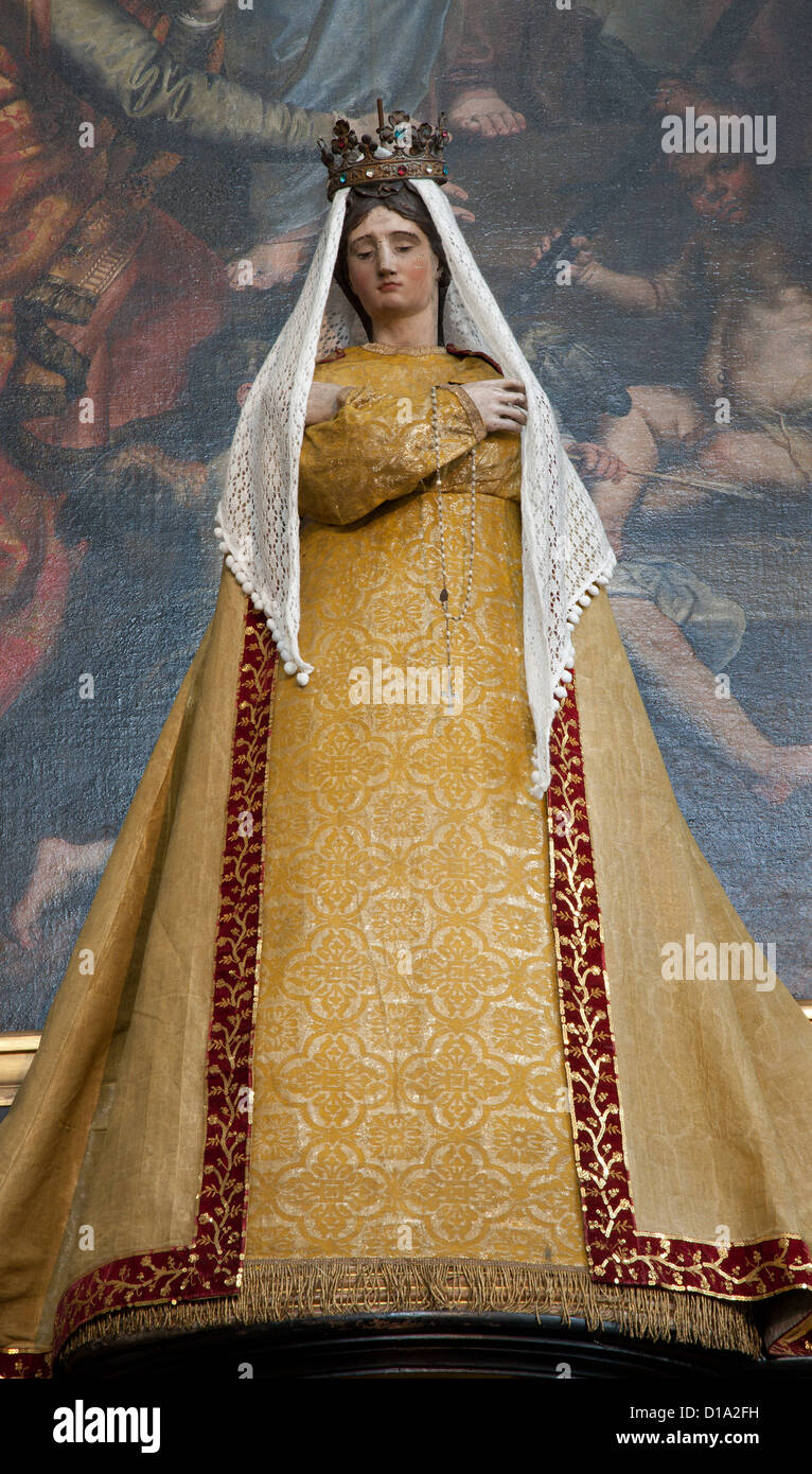 BRUSSELS - JUNE 21: Virgin Mary statue in the needlework garments from side altar at st. Nicholas church - Stock Image