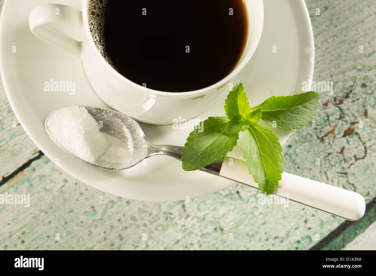 Highkey image of a cup of coffee with natural sweetener stevia - Stock Image