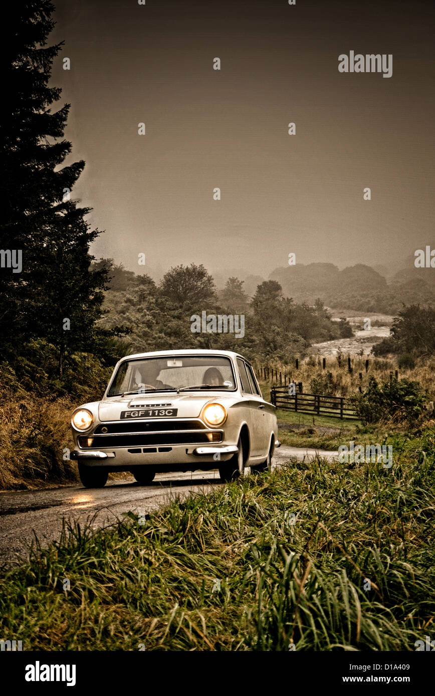 1965 Ford Lotus Cortina driving on a country road in Northumberland UK Stock Photo