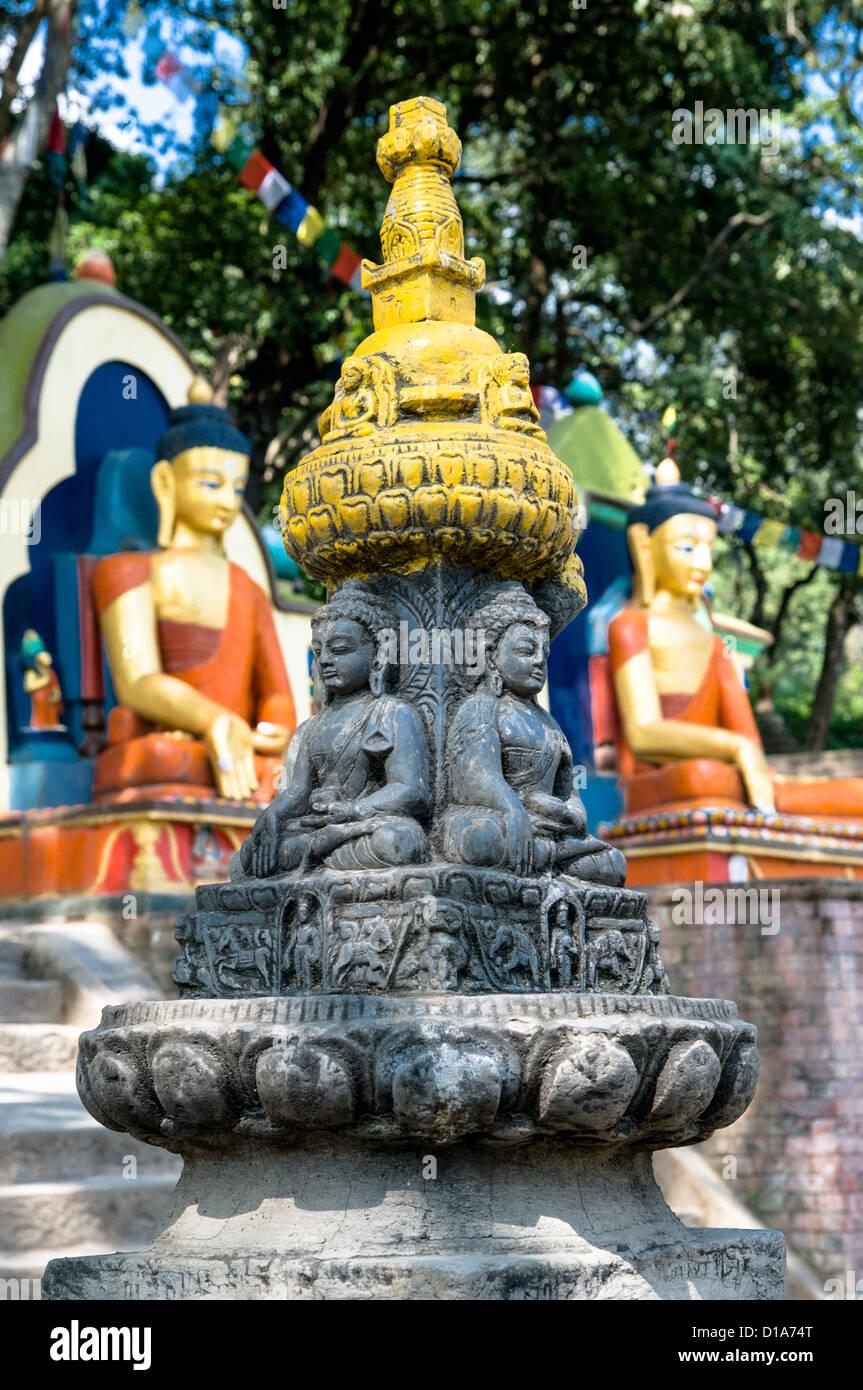 Statues at the bottom of the stairs at Kathmandu's Swayambhunath Temple, Nepal - Stock Image