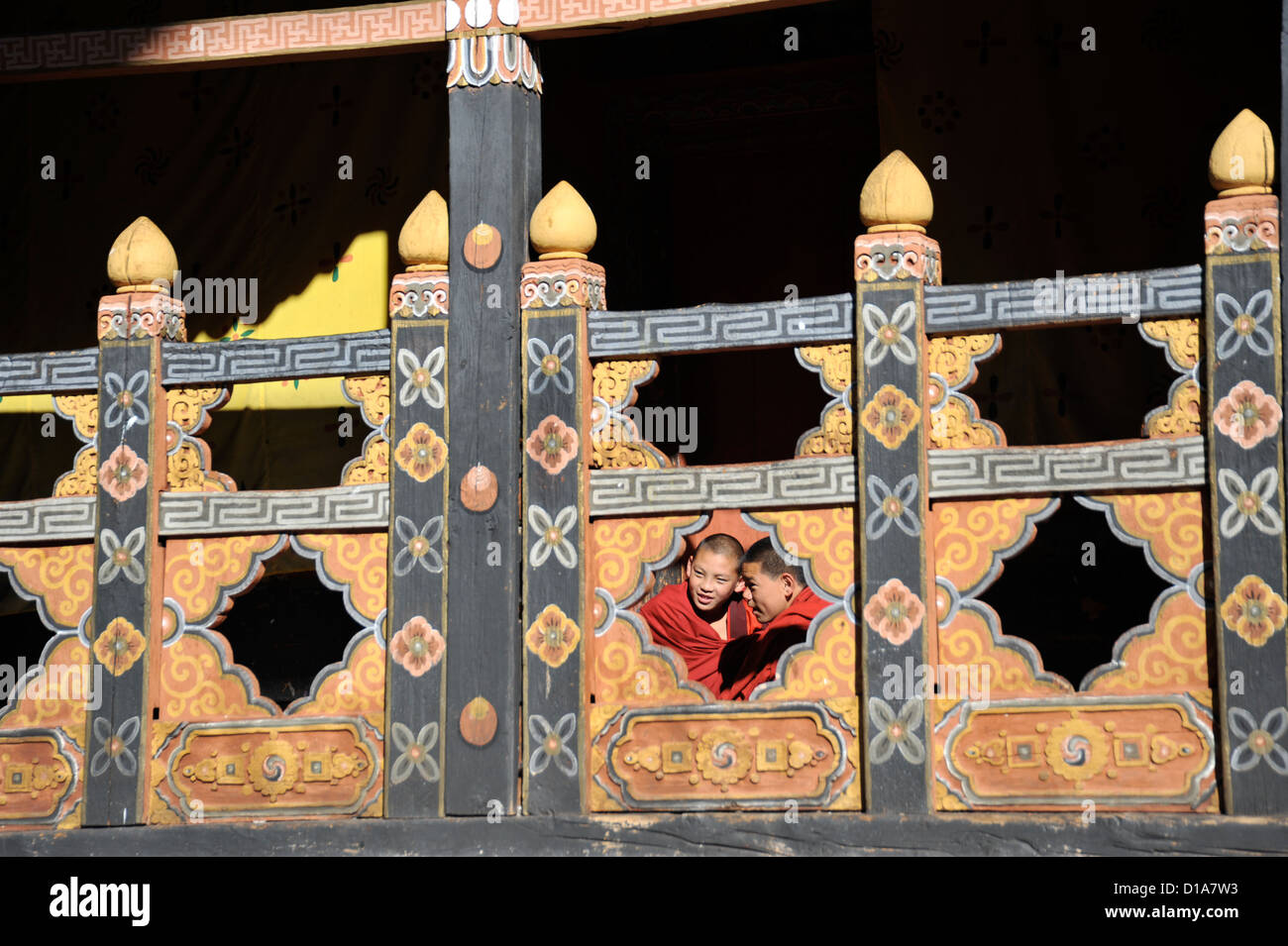 rinpung dzong,in Paro Bhutan,passing time,two monks playing Stock Photo