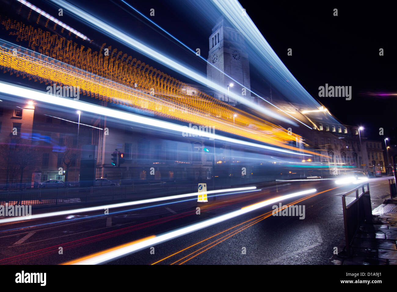 Leeds University with light trails from a passing bus at night - Stock Image