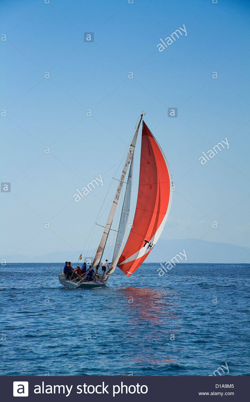 Sailing ship in Aguilas Murcia, Spain. Sailing during a race. Red sail - Stock Image
