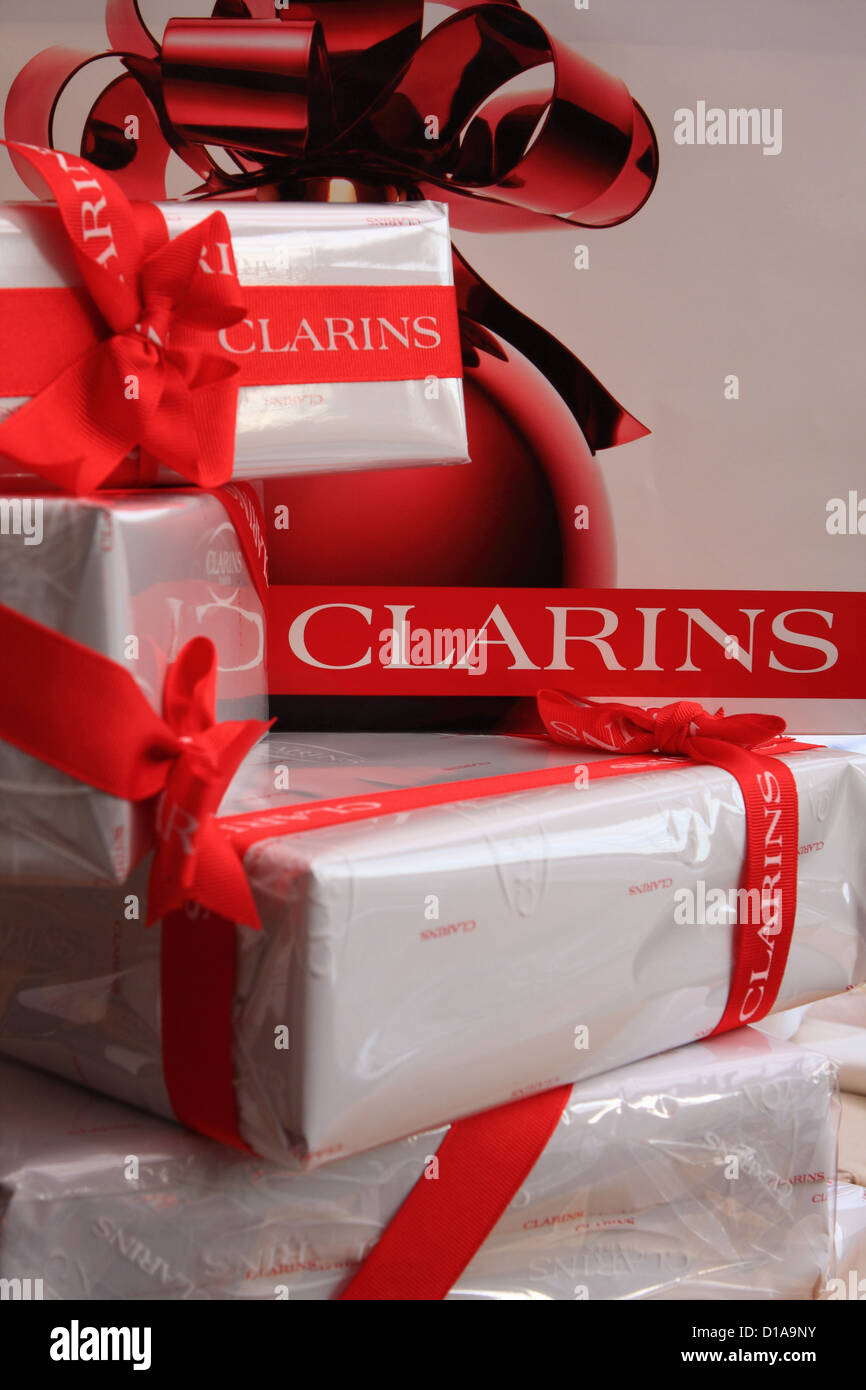 cb6f6f239b19 A pile of wrapped Clarins gifts in front of a Clarins shopping bag ...