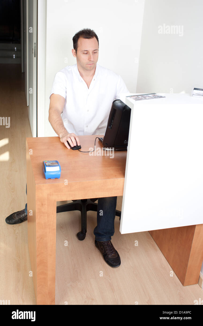 Doctor preparing an invoice - Stock Image