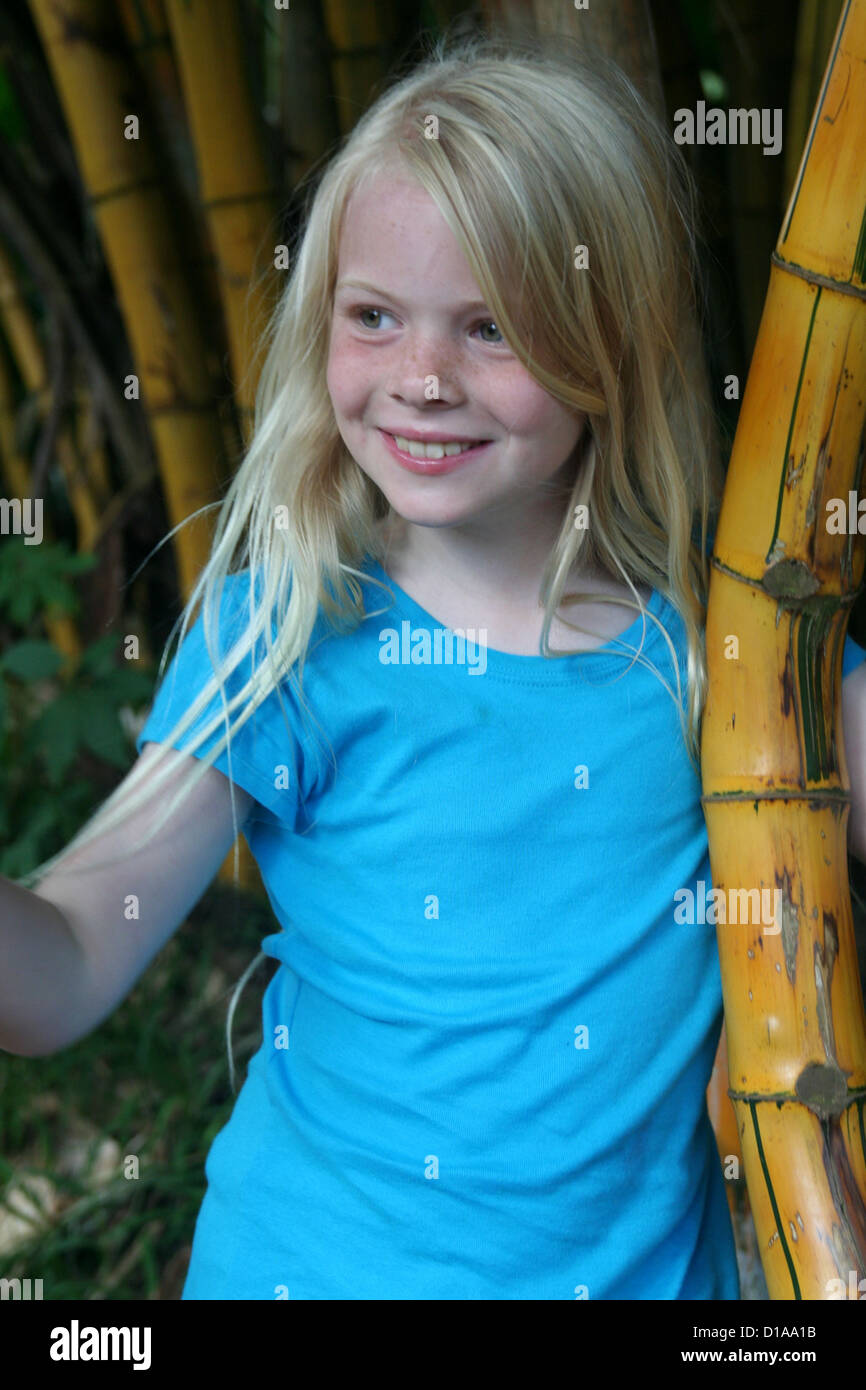 Blonde girl with bamboo Stock Photo