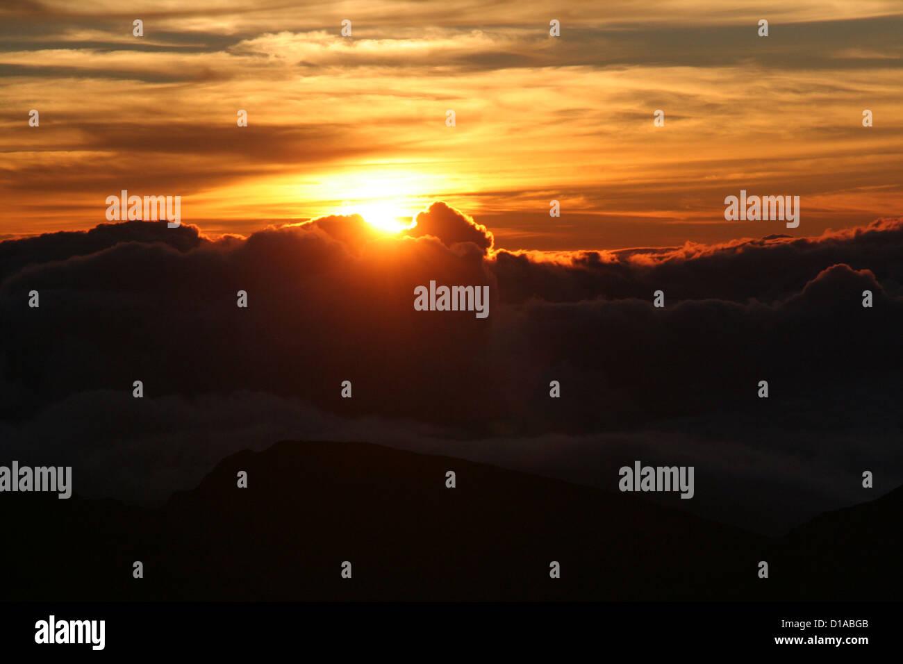 Golden sunrise from Haleakala volcano, Maui, Hawaii Stock Photo