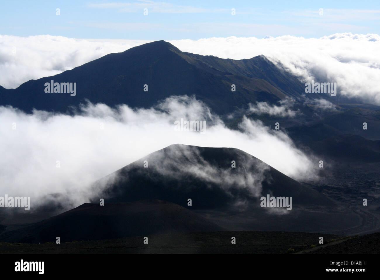 Fog and clouds among the cinder cones on Haleakala volcano, Maui, Hawaii Stock Photo