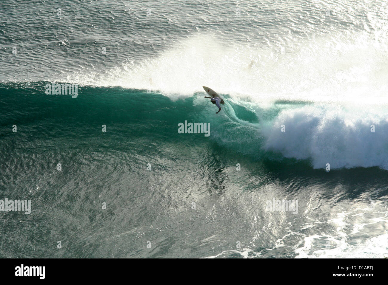 Surfer riding a wave, Maui, Hawaii Stock Photo