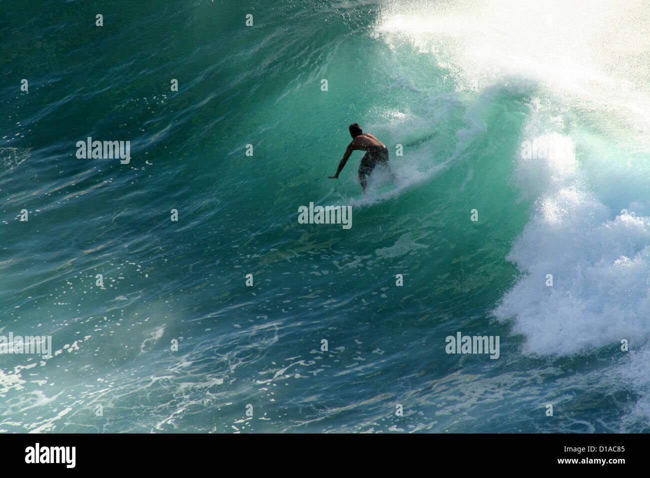 Surfer riding a wave, Maui, Hawaii Stock Photo