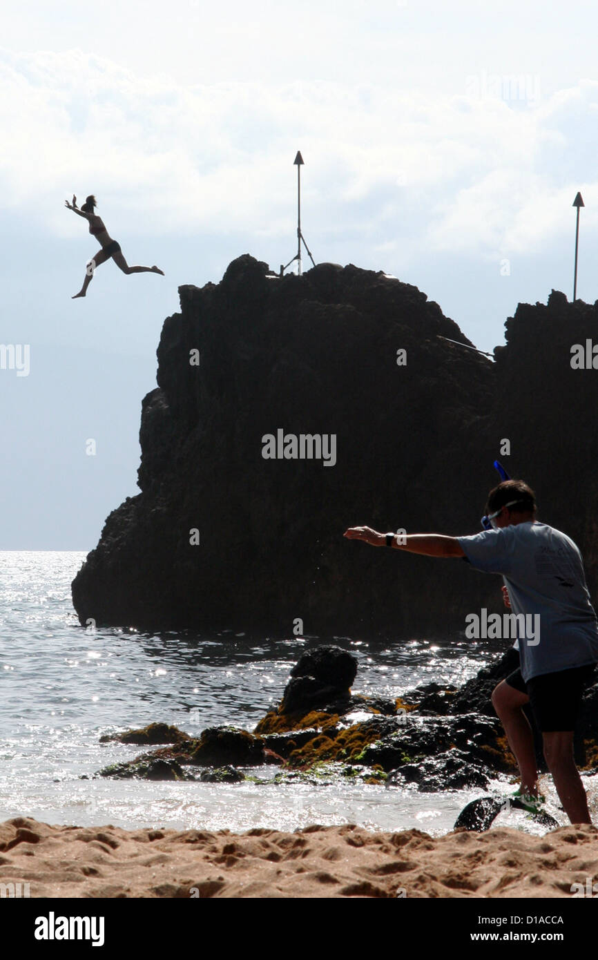 Silhouette of cliff jumper at Black Rock Beach, Maui Island, Hawaii, USA Stock Photo