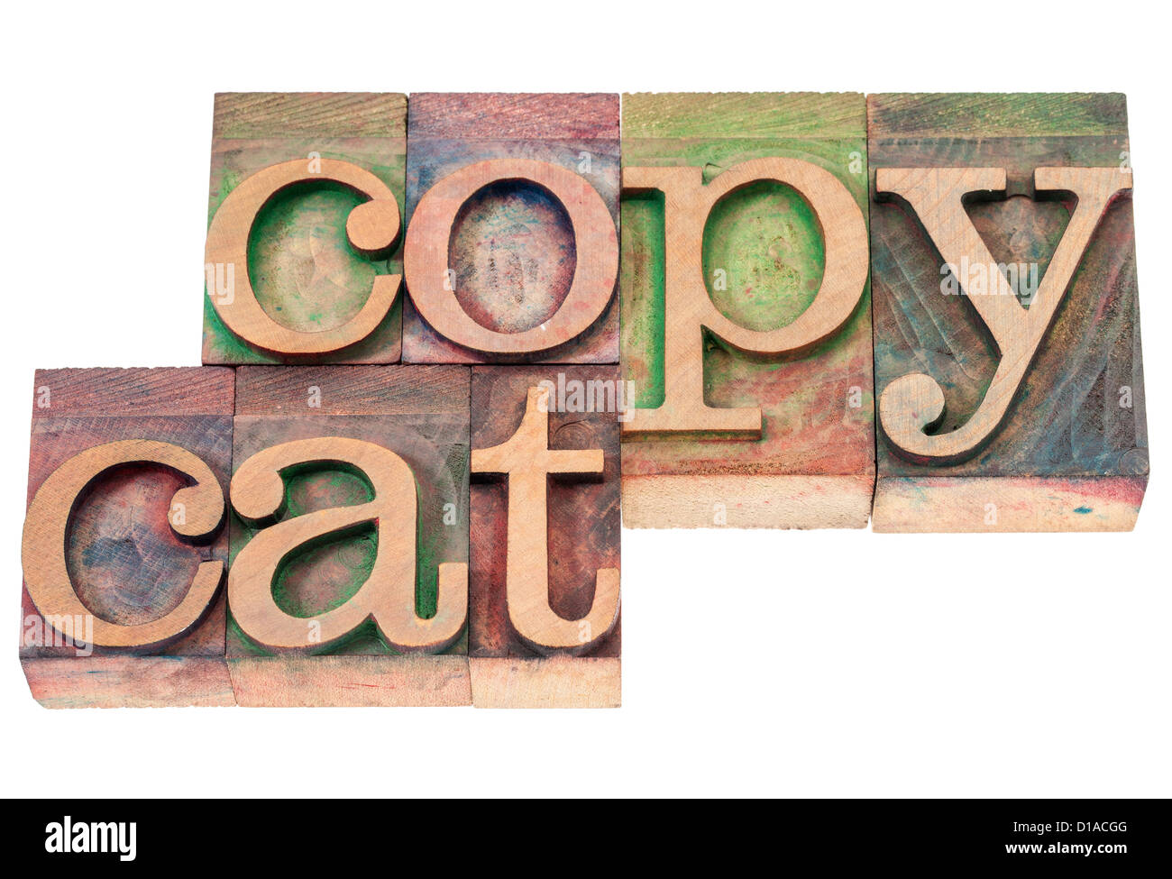 copycat - isolated text in vintage letterpress wood type blocks stained by color inks - Stock Image