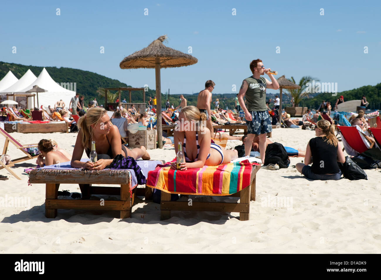 Essen, Germany, two girls on the beach on the sun loungers Baldeneysee - Stock Image
