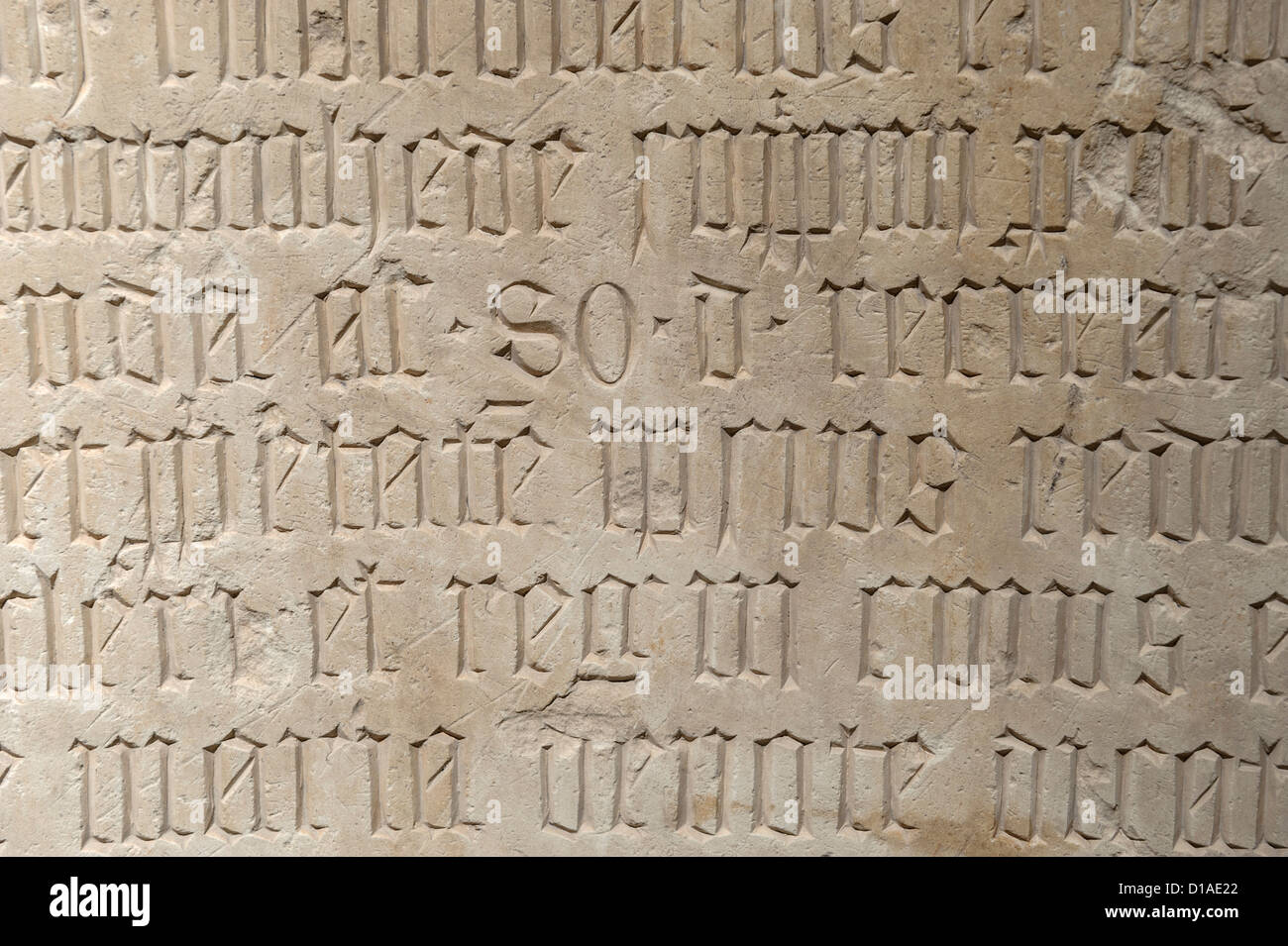 Ancient medieval writings etched on stone - Stock Image