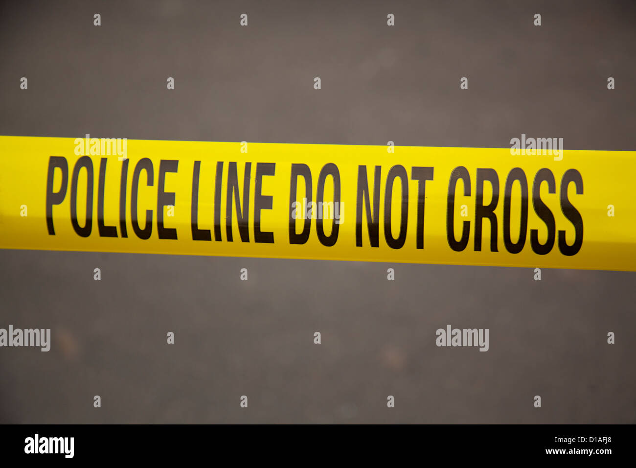 police line do not cross yellow tape - Stock Image