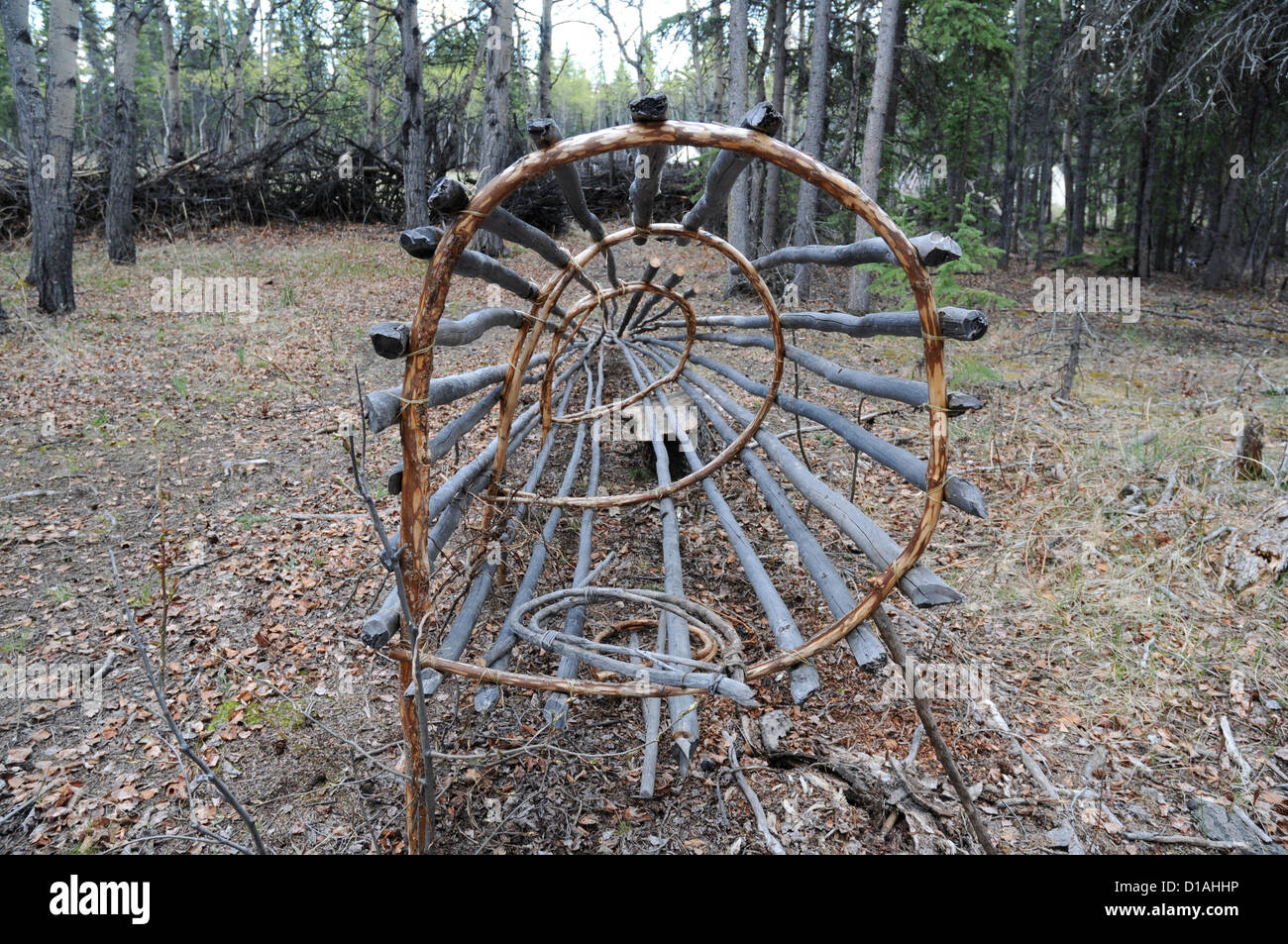 Looking through the mouth of a traditional Native American salmon fish trap, displayed in the town of Champagne, Stock Photo