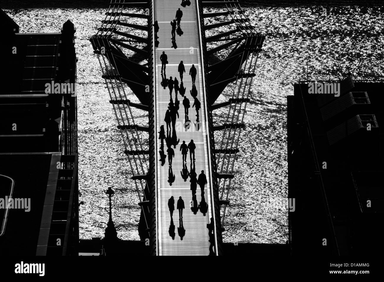 Aerial view of pedestrians walking across the Millennium Bridge, London, UK - Stock Image