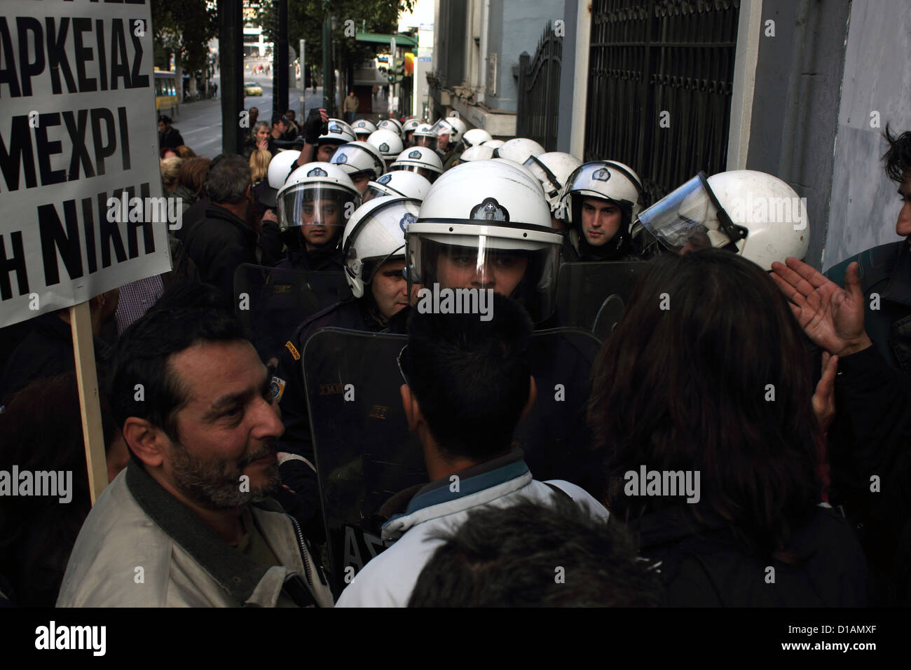Police forces and demonstraters in Athens. - Stock Image